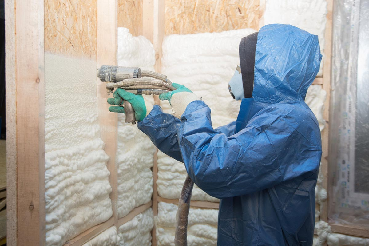 Open-cell Spray Foam Insulation Being Applied In Walls